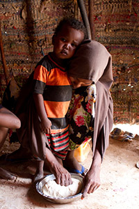 Interanlly Displaced Somali Woman makes bread for her children