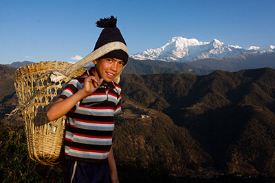 Boy with Basket in Nepal