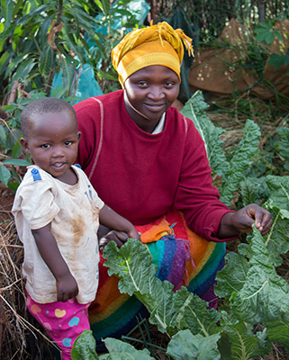 Woman and her Baby in Garden in Rwanda
