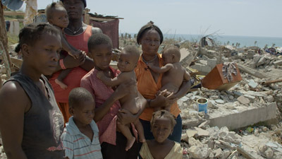Haitian Family by destroyed house