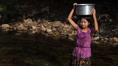 Girl Collects Water
