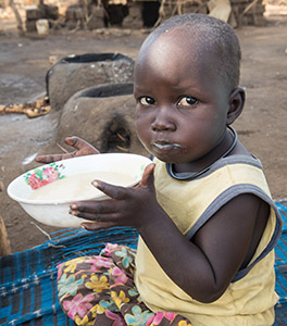 Baby in Africa eats Emergency Food Rations