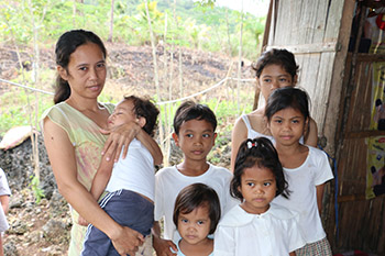 Mother in the Philippines and her children