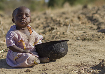Hungry Baby in Kenya with food bowl