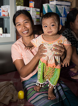 Mother and her baby at a health clinic in Myanmar
