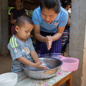 Boy learns to wash hands in Myanmar