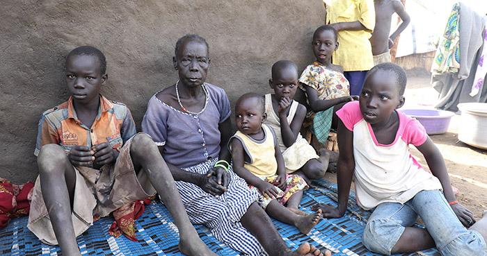 Grandmother and her grandchildren in Bidibidi Camp in Uganda