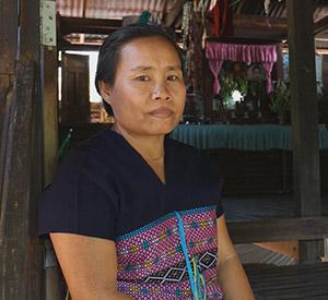 Karen Ethnic woman in Myanmar in her doorway