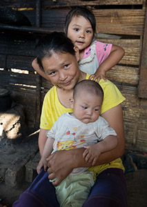 Woman in Myanmar with her children