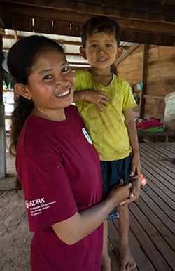 Woman in Cambodia with her son