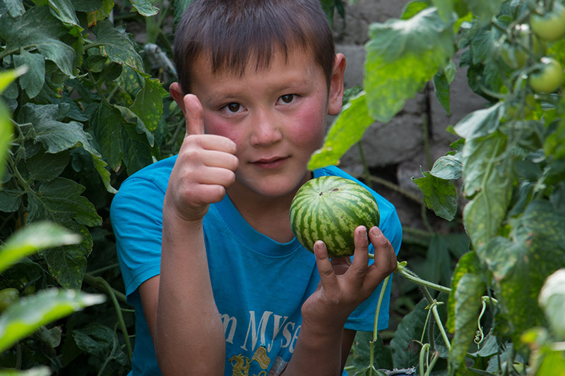 Mongolian Boy with Melon