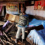 Kenya Boy in Home damaged by flooding