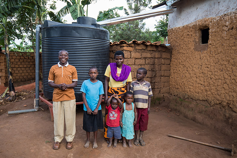 Family by their Rainwater tank
